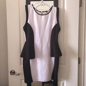 Beautiful new white and black peplum dress